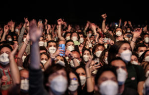 Attendees react during a concert by band Love of Lesbian at Sant Jordi stadium in Barcelona, Spain, on Saturday, March 27, 2021. The public, the staff and the band are part of a mass experiment that organizers say is the largest concert without social distancing of the coronavirus era. Photographer: Angel Garcia/Bloomberg